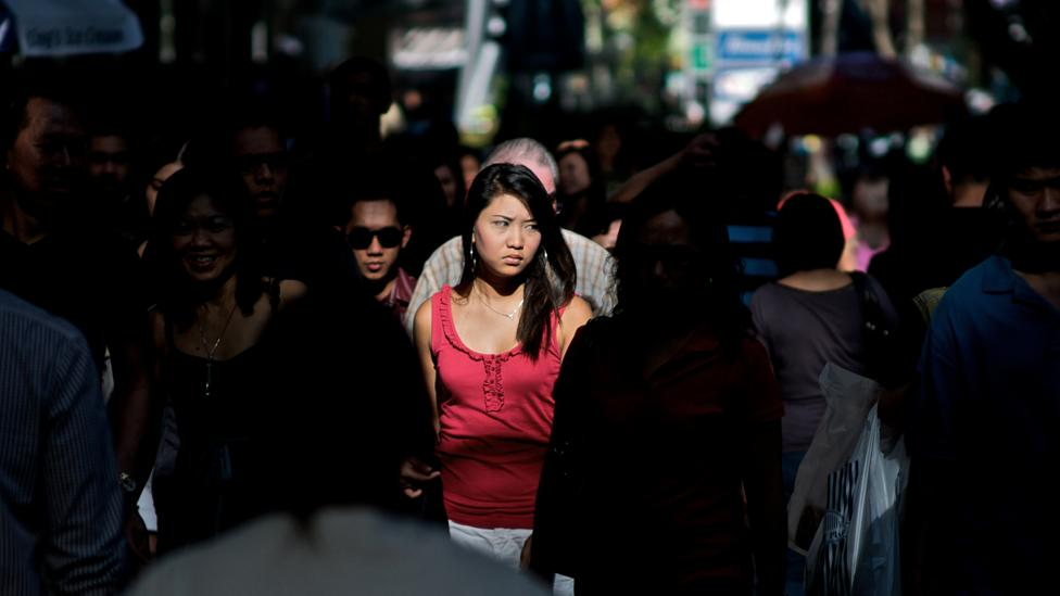 Santos photographed strangers just after moving to Singapore (Credit: Danny Santos)