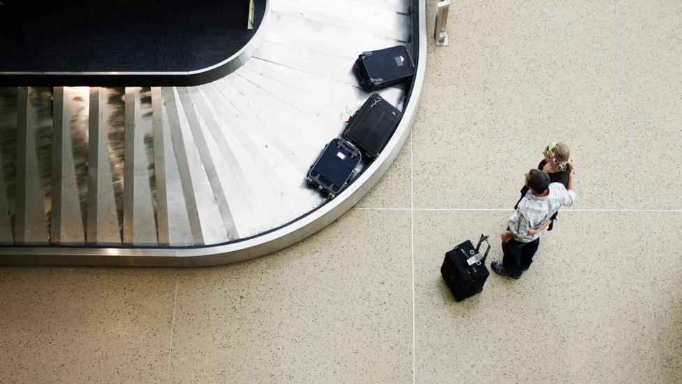 Heavy bags can be an added stress, leaving travellers tired and frustrated (Credit: Getty Images)