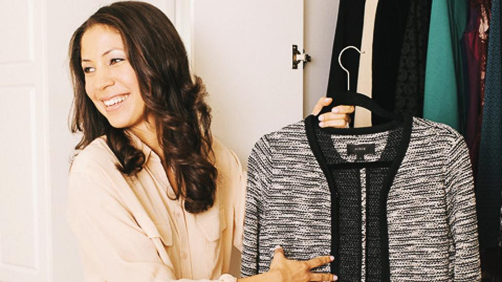 There's no magic number of clothing to own, says Jennifer Scott, standing in front of her 10-item closet. (Credit: Danny Liao)
