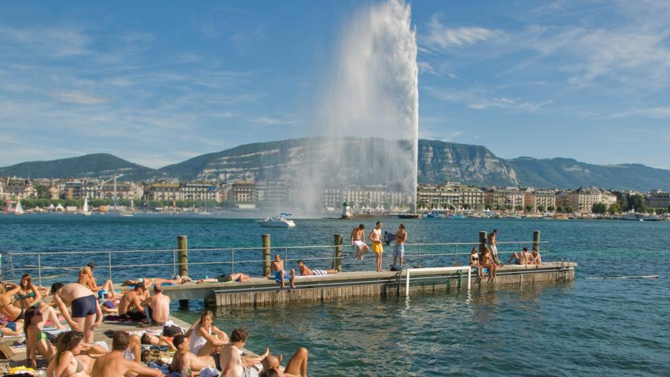 Lakeside sunbathing, Geneva, locals spend much of their leisure time relaxing here or doing water sports (Credit: Alamy)