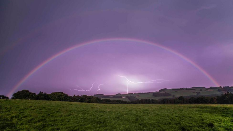 In this image released on 18 October 2016, a moonbow is visible in the night sky above a field in the Coquet Valley in Northumberland, England (Credit: Ian Glendinning/AP)