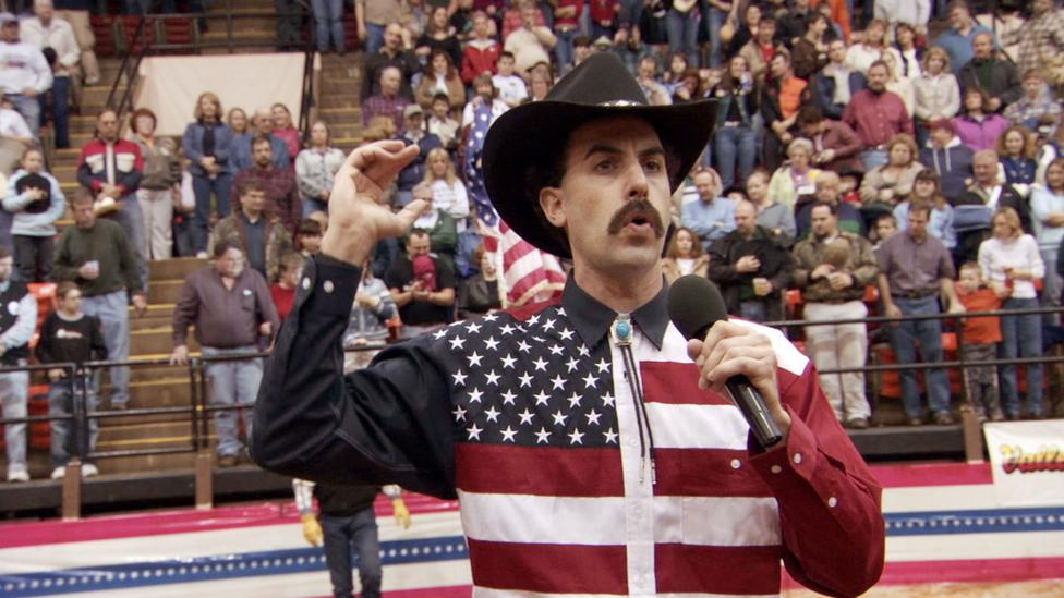 "At a US rodeo Borat elicited applause when he declared, ""May your George Bush drink the blood of every man, woman and child in Iraq"" (Credit: Alamy)"