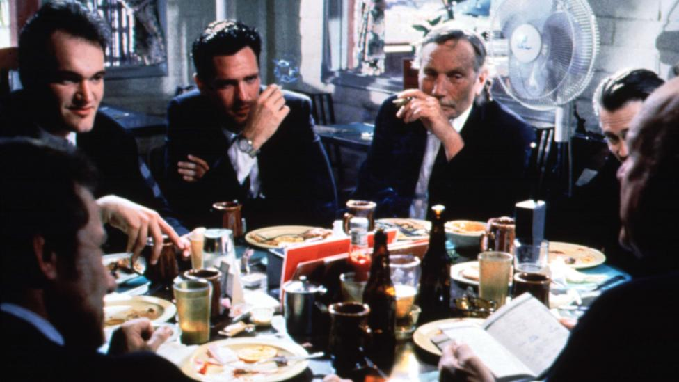 Tarantino opens the film with the characters around a diner table – juvenile, volatile and afraid of women (Credit: Moviestore Collection Ltd / Alamy Stock Photo)