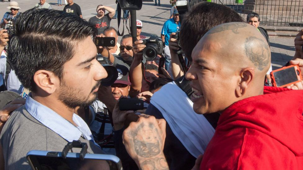 Two people argue during a protest march against the rise in the price of fuel in Monterrey, Mexico, on 15 January 2017 (Credit: Julio Cesar Aguilar/AFP/Getty Images)