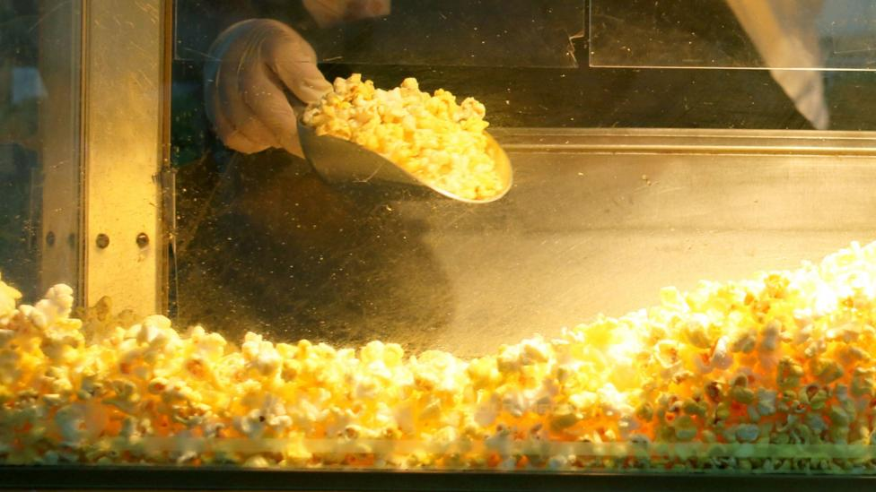 Higher sales of popcorn in cinemas was taken as a sign of economic recovery in Britain following the financial crisis of 2008 (Credit: Getty Images)