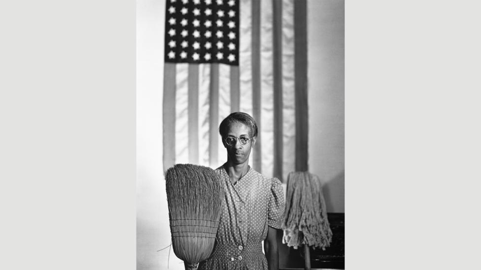 Gordon Parks' 1942 photograph of Ella Watson riffs on American Gothic for a serious rather than comic effect (Credit: Getty Images)