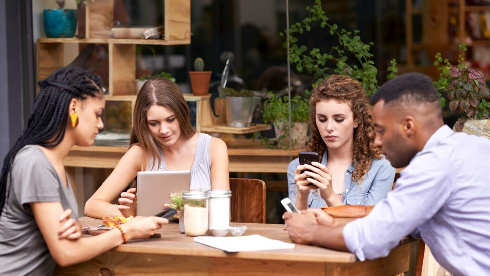 Is it time to stop looking at our devices in cafes? (Credit: Getty Images)