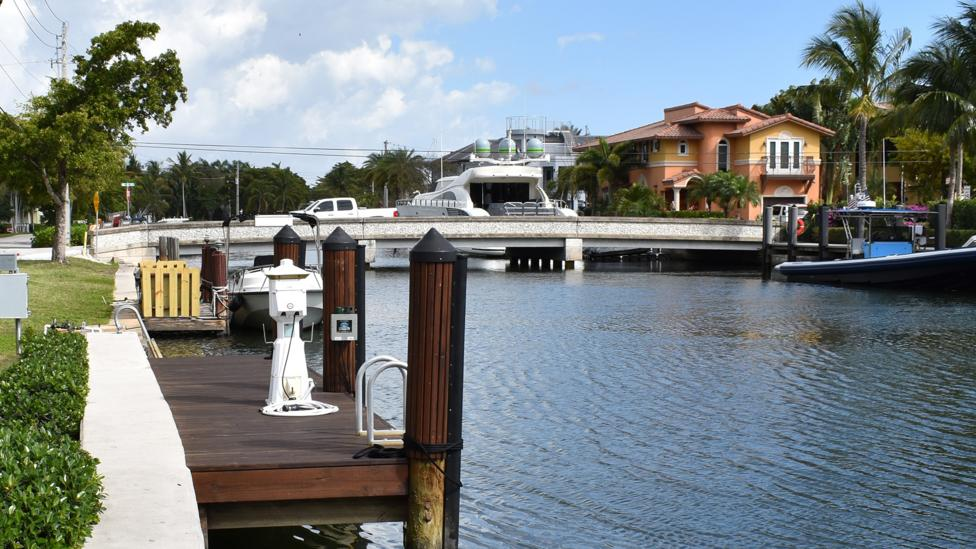 With its varying seawall heights, new decks and bridge, this corner of Fort Lauderdale shows the domino effect of changing one piece of infrastructure (Credit: Amanda Ruggeri)