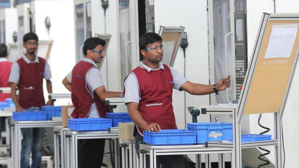 India is trying to future-proof job loss by acquainting students and workers to changing tech - workers are seen here in a Bangalore automation factory (Credit: Alamy Stock Photo)