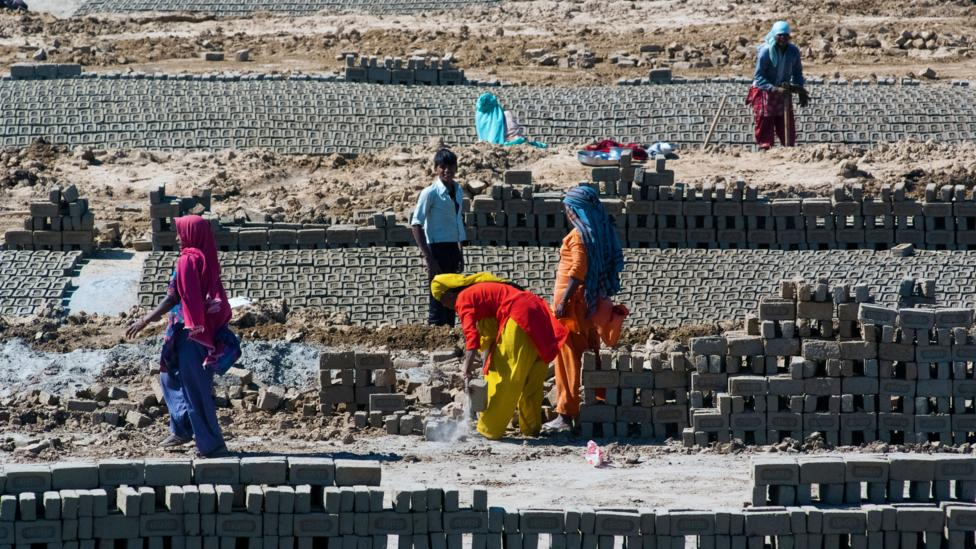Repetitive, labourious tasks, like the brick-laying seen here in Uttar Pradesh, are especially at risk of being replaced with smart machines (Credit: Alamy Stock Photo)