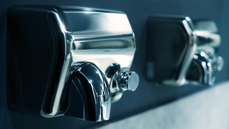 Older hand dryers took a long time to dry - but modern jet dryers are much faster (Credit: iStock)