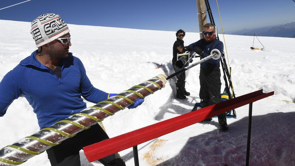 Scientists with an ice core in Antarctica (Credit: Getty Images)