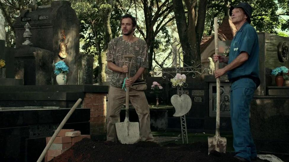 Many Brazilian horror films are deeply rooted in local environs, such as The Necropolis Symphony, a musical about a gravedigger (Credit: Filmes do Caixote/ Vitrine Filmes)