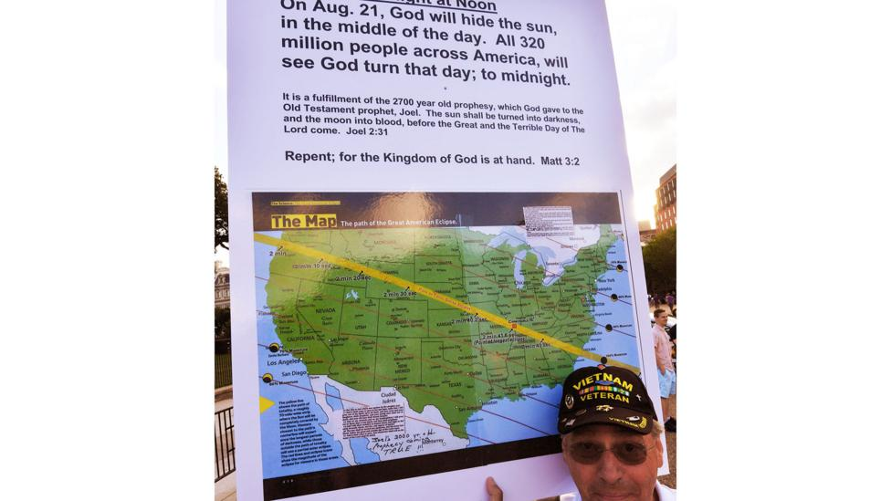 """""""Repent; for the Kingdom of God is at hand,"""" reads one sign held by an eclipse doomsday believer in Washington DC last month (Credit: Getty Images)"""