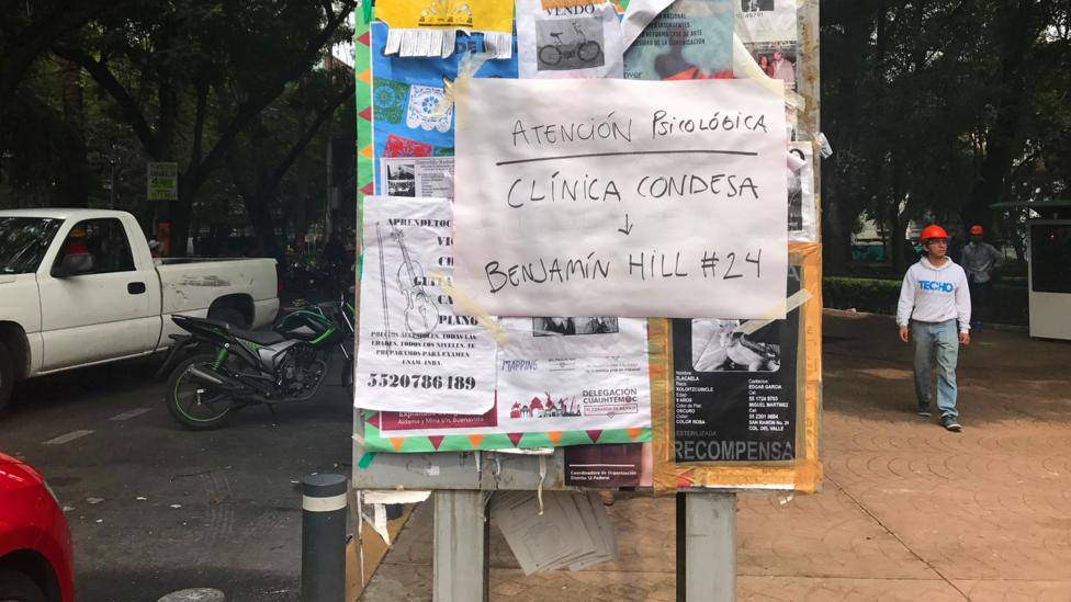 A sign in Mexico City advertises psychological help to residents. Some psychologists took to writing their names and numbers (Credit: Julissa Trevino)