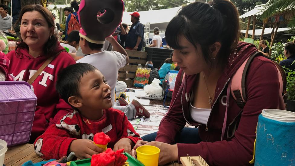 Karla Martínez, a pedagogy student at UNAM, plays with a Isaac, 4, at a shelter in Colonia Roma (Credit: Julissa Trevino)