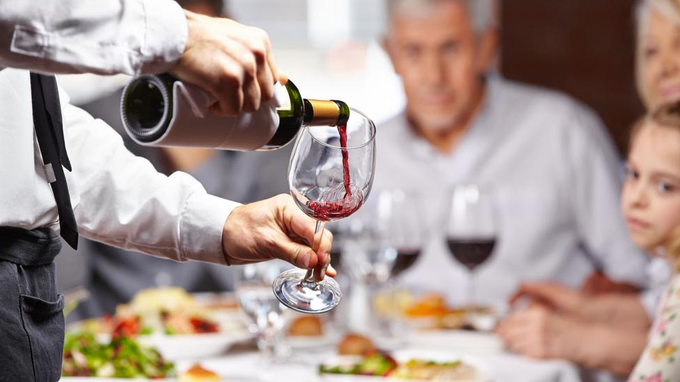 If a wine has a more difficult to read label, some wine drinkers might be more inclined to like it (Credit: Alamy)