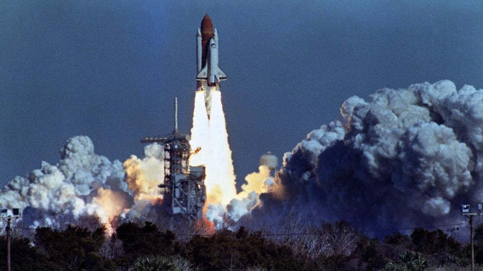 US space shuttle Challenger lifts off 28 January 1986 from a launch pad at Kennedy Space Center, 72 seconds before its explosion killing it crew of seven. (Credit: Getty Images)