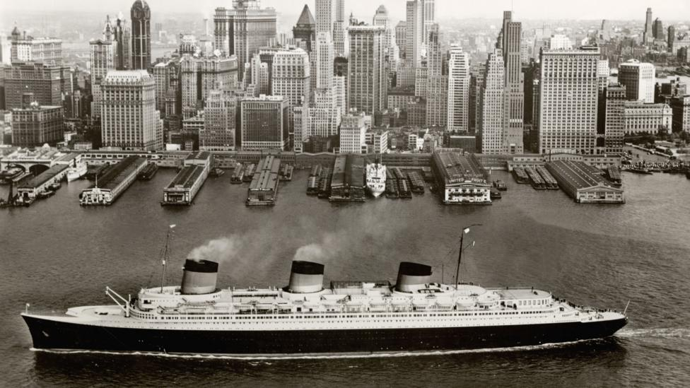 Ocean liners such as the Normandie, shown in New York, were symbols of luxury and modernity (Credit:Collection French Lines)
