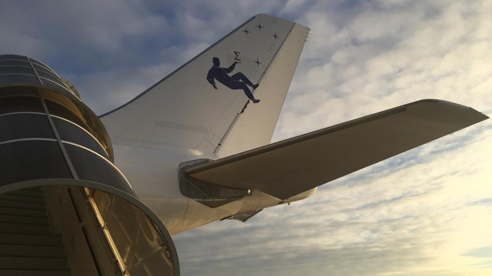 The plane's tail features a human floating in space (Credit: Sue Nelson)