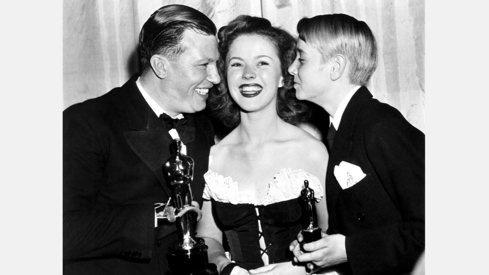 Winners of the Juvenile Academy Award, such as Claude Jarman Jr, right, received a smaller statuette – Harold Russell, left, is the only winner to sell his Oscar (Credit: Alamy)