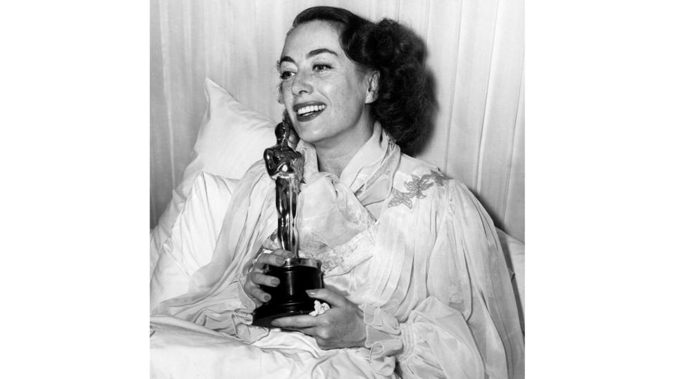 It's believed that Joan Crawford feigned illness to avoid attending the Oscars ceremony in 1946 because she thought she'd lose best actress – but she won  (Credit: Alamy)