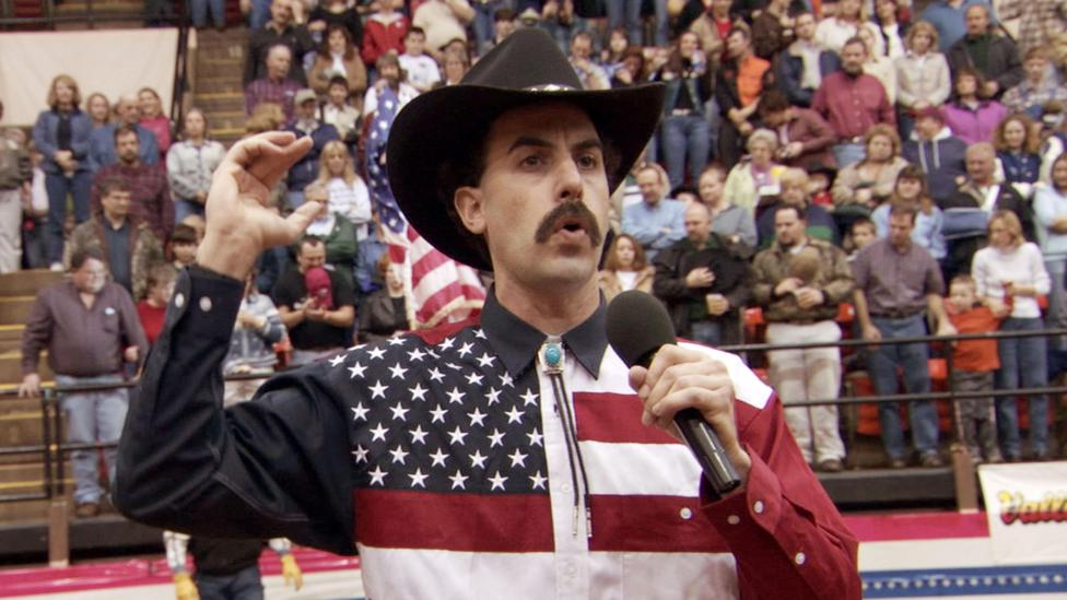 Sacha Baron Cohen is known for adopting satirical accents (Credit: Alamy)