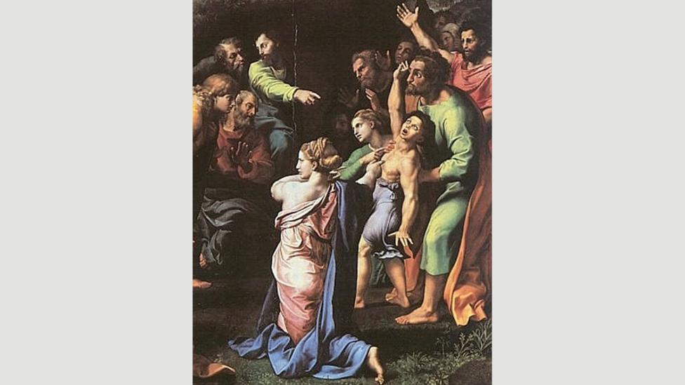 Raphael's The Transfiguration (1518-1520) has similar elements to Gonzalez's photo: flung arms,finger pointing and beatific expressions (Credit: Wikimedia)