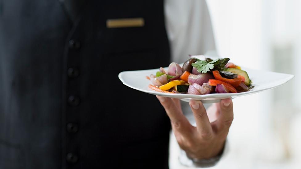 Even the physique of a waiter could influence the size of our order, research has suggested (Credit: Getty Images)