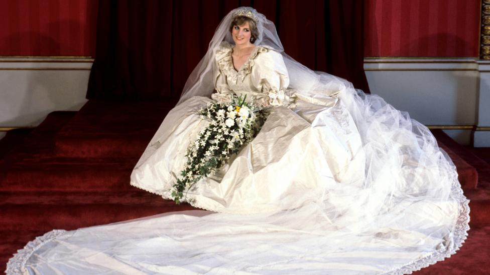 The voluminous taffeta wedding dress worn by Prince Harry's mother, Diana, Princess of Wales, was created by the Emmanuels (Credit: Press Association)
