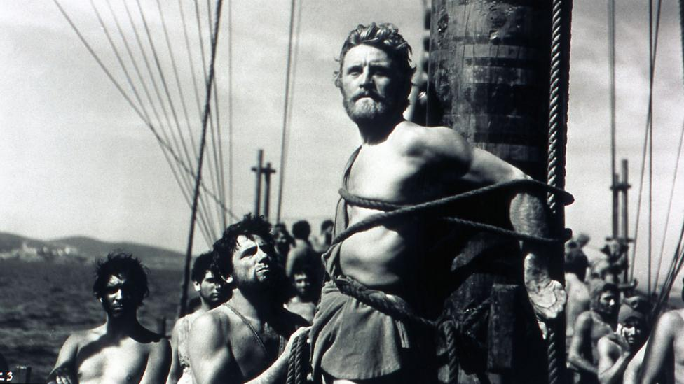 Kirk Douglas played Ulysses in the 1954 film based on Homer's epic – in this scene, he listens to the song of the Sirens while strapped to a ship's mast (Credit: Alamy)