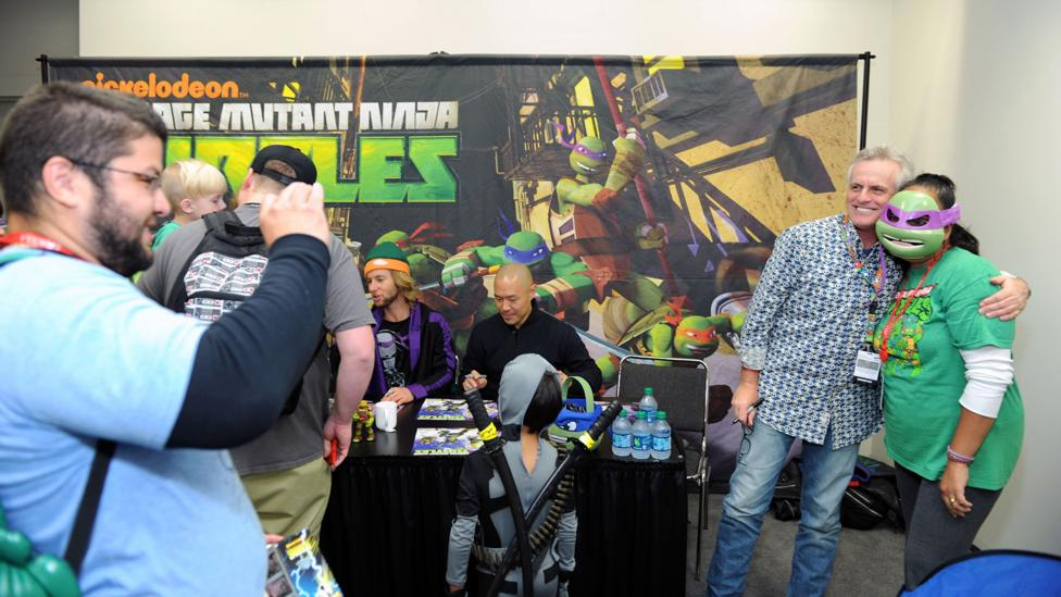 Rob Paulsen poses with a fan at a convention. He voiced Raphael in the original Teenage Mutant Ninja Turtles and Donatello in the recent remake (Credit: Getty Images)