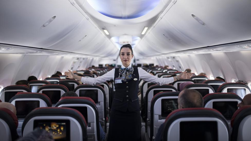 Cabin crew have to maintain an air of friendliness even when faced with abusive or combative passenger behaviour (Credit: Getty Images)