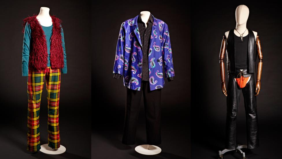 Furry red gilet and tartan trousers, 1978; purple paisley jacket and Cartier shirt, 1985; leather chaps and waistcoat, 1992 (Credit: Brighton Museum & Gallery)