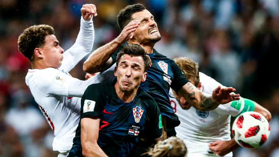 Dele Alli (left), Harry Kane (right), Mario Mandzukic (front) and Dejan Lovren in the semi-final match between England and Croatia (Credit: Valery Sharifulin/Getty Images)