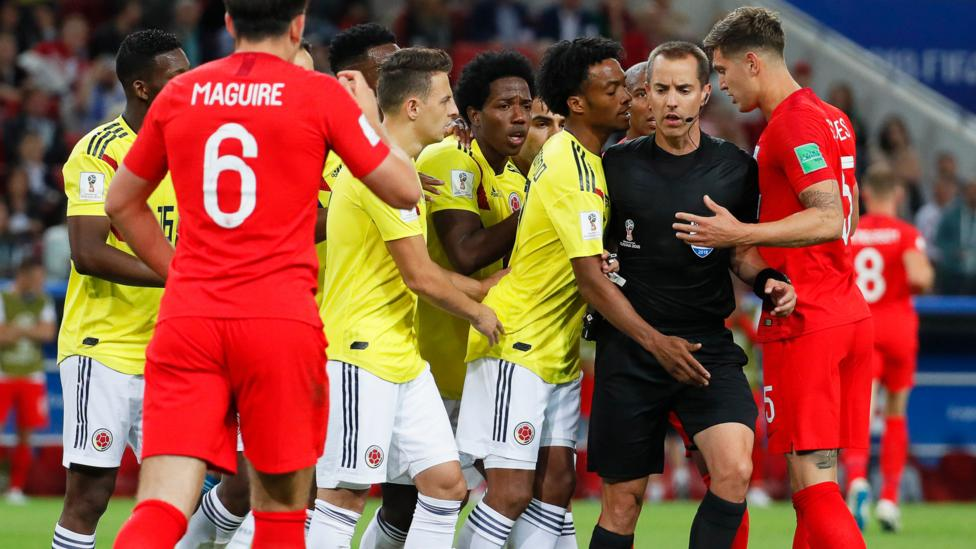 Players react as US referee Mark Geiger awards a penalty during the match between Colombia and England on 3 July (Credit: EPA)