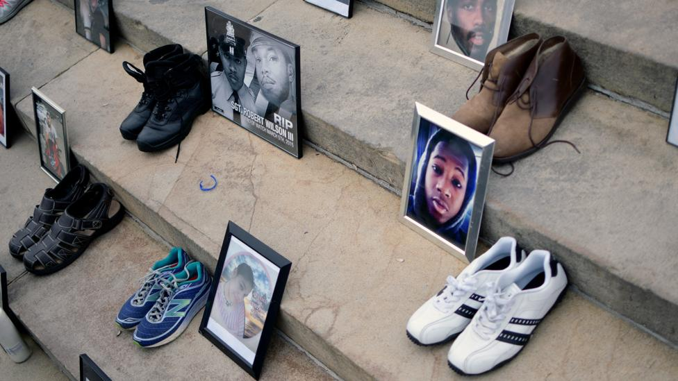 Photos and shoes of gun violence victims are exhibited at an anti-gun rally in Philadelphia in 2018 (Credit: Getty Images)