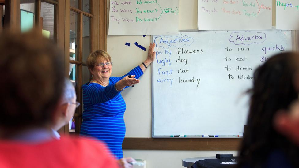 At a Massachusetts church, immigrants to the US sit in an English class (Credit: Getty Images)