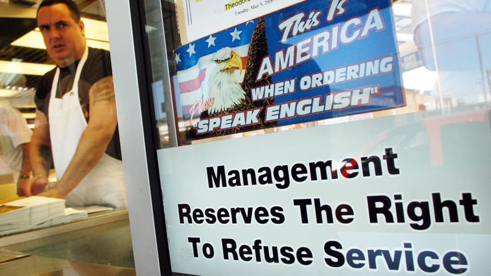 This sign hung in a Philadelphia sandwich shop in 2006, which provoked controversy - it was eventually removed from the window (Credit: Getty Images)