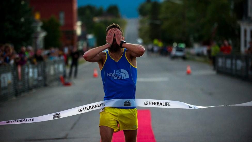 Rob Krar crosses the finish line to win the 2014 Leadville Trail ultramarathon with a time of 16:09:31 (Credit: Getty)
