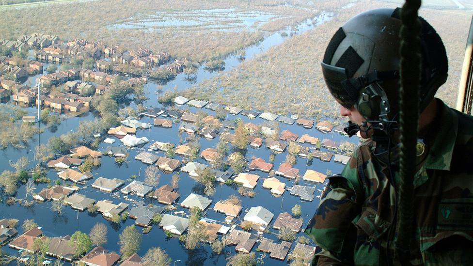 …as this image of the search for Hurricane Katrina survivors, which shows the impact of climate change in a more recognisable environment (Credit: Master Sgt Bill Huntington)