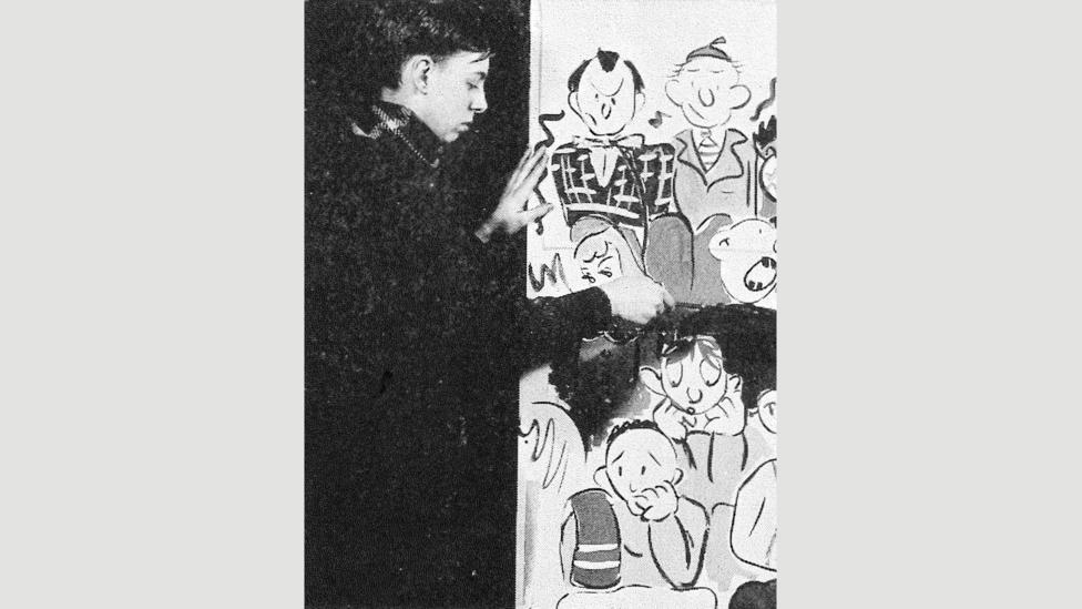 Gorey at work on a mural for a high-school social event, from the Parker Record yearbook (1942) (Credit: Francis W Parker School, Chicago)