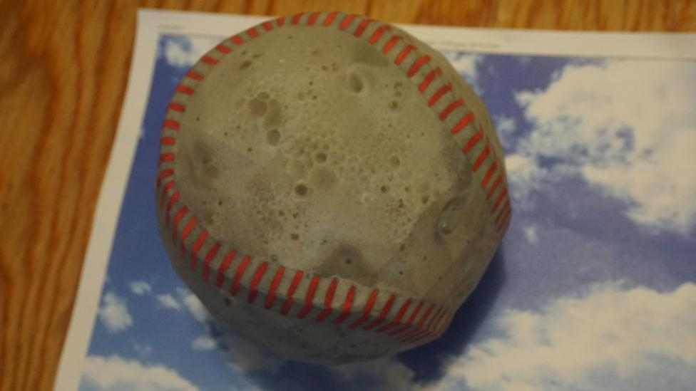 By subtly changing the texture of an object, researchers were able to make a 3D printed baseball look like an espresso (Credit: MIT)