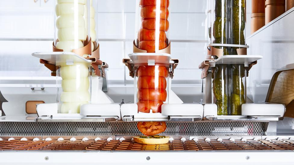 The Creator robot slices toppings directly onto the bun, helping to reduce the amount of tedious work in the kitchen and keeping ingredients fresher (Credit: Creator)