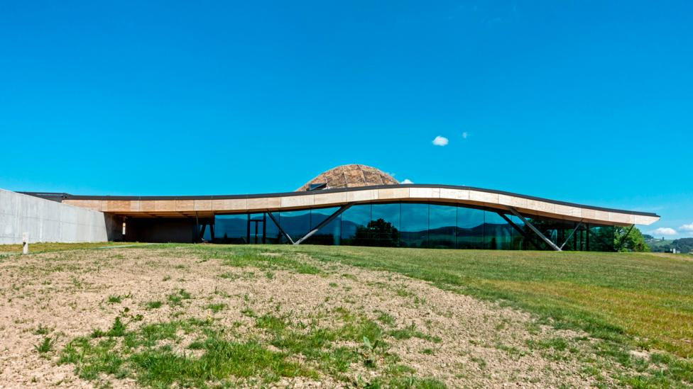 The Macallan whisky distillery has an undulating timber roof and blends in with the landscape (Credit: Alamy)