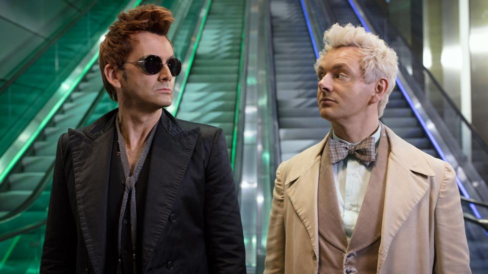 In Good Omens, David Tennant's demon and Michael Sheen's angel try to prevent the apocalypse happening (Credit: Amazon Prime Video)