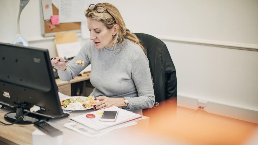 Productivity experts say a conscious break, rather than a hastily eaten desk lunch, makes people work more effectively (Credit: Getty Images)