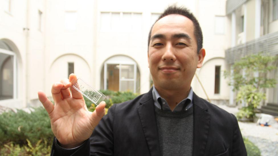 "Ken-Ichiro Kamei holding one of his ""bodies on a chip"" (Credit: Rachel Nuwer)"