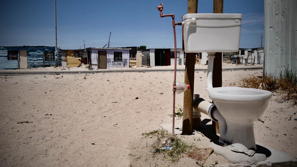 Open toilet in slum (Credit: Getty Images)