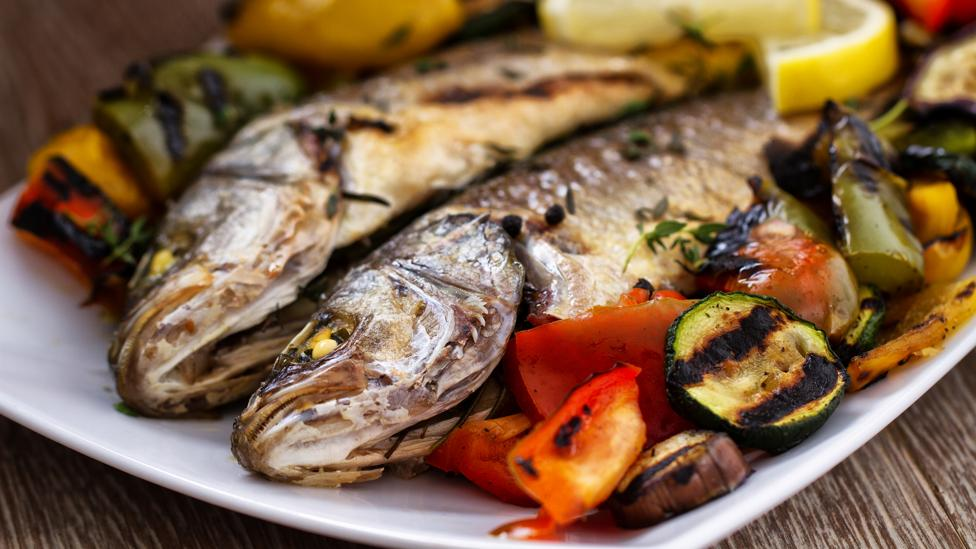 One study found a Mediterranean diet, which includes small amounts of fish, was found to create substances crucial to colon health (Credit: Getty Images)